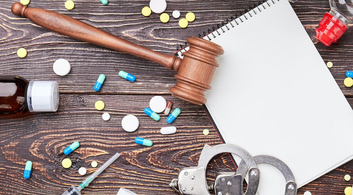 Fitness equipment, pills, top view. Drugs in sport training and law verdict.
